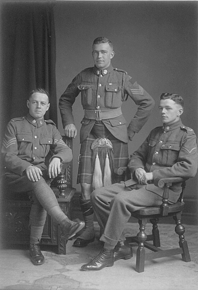Pipe Major Alexander A. Newlands (center) with brothers, 2nd Pipe Major 15th Battalion